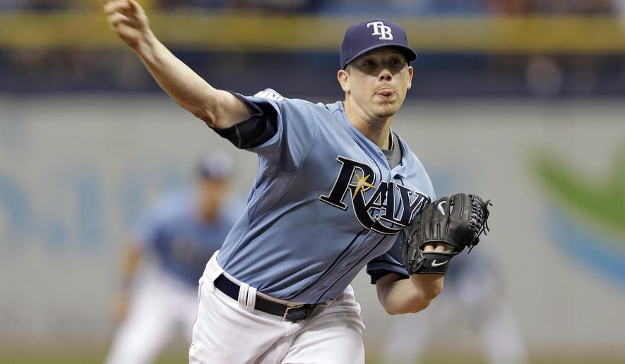 Tampa Bay Rays starting pitcher Jeremy Hellickson delivers to the New York Yankees during the first inning of a baseball game Sunday, Aug. 17, 2014, in St. Petersburg, Fla. (AP Photo/Chris O'Meara)