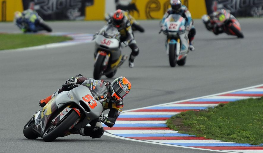 Esteve Rabat, of Spain, front, rides during the Czech Republic motorcycle Grand Prix Moto 2 motorcycle race at the Brno Circuit, Czech Republic, Sunday, Aug. 17, 2014. (AP Photo/CTK, Lubos Pavlicek) SLOVAKIA OUT