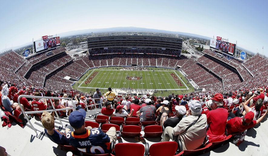 In this photo taken with a fisheye lens, fans at Levi's Stadium watch as the San Francisco 49ers play the Denver Broncos during the first half of an NFL preseason football game in Santa Clara, Calif., Sunday, Aug. 17, 2014. (AP Photo/Tony Avelar)