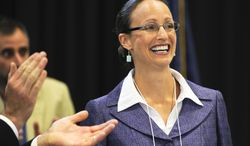 Amanda Curtis, a state legislator from Butte, Mont. smiles after being selected as the replacement candidate in the U.S. Senate race against Republican Rep. Steve Daines, in Helena, Mont. on Saturday, Aug. 16, 2014. (AP Photo/Independent Record, Thom Bridge)