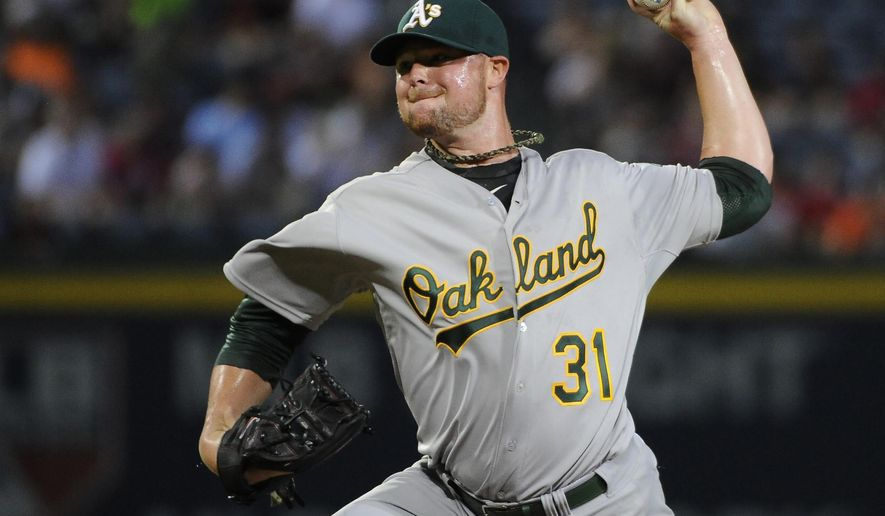Oakland Athletics starting pitcher Jon Lester delivers to the Atlanta Braves during the first inning of a baseball game Sunday, Aug. 17, 2014, in Atlanta. (AP Photo/David Tulis)