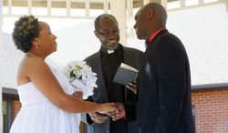 Pastor Robert Davis, the father of the groom, center, conducts the marriage ceremony between Miriam Reeves, left, and Mark Davis beneath the gazebo in the courtyard of Foundation Park Alzheimer's Care on Saturday, Aug. 16, 2014. (AP Photo/The Toledo Blade, Amy E. Voigt) MANDATORY CREDIT, MAGS OUT, NO SALES, TV OUT, BOWLING GREEN SENTINEL-TRIBUNE, MONROE EVENING NEWS AND THE TOLEDO FREE PRESS OUT