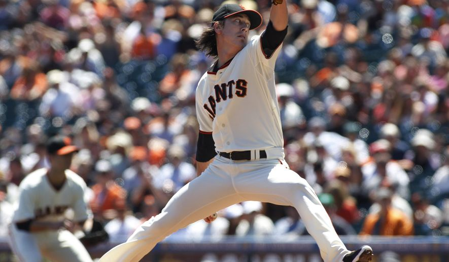 San Francisco Giants pitcher Tim Lincecum throws to the Philadelphia Phillies during the first inning of a baseball game, Sunday, Aug. 17, 2014, in San Francisco. (AP Photo/George Nikitin)