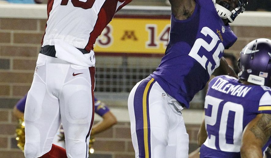 Arizona Cardinals wide receiver Jaron Brown catches a pass over Minnesota Vikings defensive back Chris Crocker (25) during the first half of an NFL preseason football game, Saturday, Aug. 16, 2014, in Minneapolis. (AP Photo/Ann Heisenfelt)