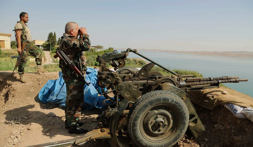 Kurdish forces, known as peshmerga, retook parts of Mosul Dam on Sunday, less than two weeks after Baghdad's vital water source was captured by Islamic State fighters. (Associated Press)