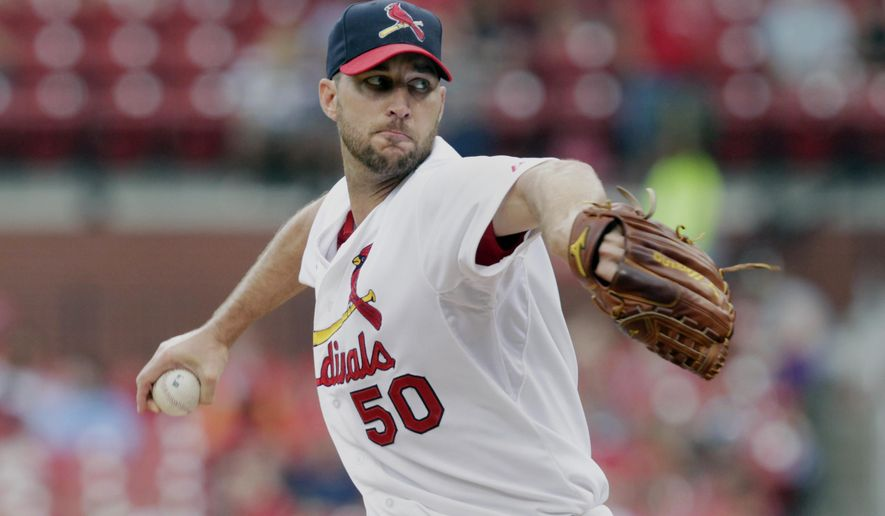 St. Louis Cardinals starting pitcher Adam Wainwright (50) sets to deliver a pitch in the first inning of a baseball game against the San Diego Padres, Sunday, Aug. 17, 2014, in St. Louis. (AP Photo/Tom Gannam)