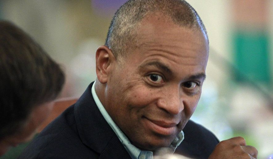 FILE - In this July 14, 2014 file photo, Massachusetts Gov. Deval Patrick talks with his staff at the New England Governors and eastern Canadian Premiers 38th annual conference in Bretton Woods, N.H. As he nears the end of his second term, Patrick has embarked on a trip around the globe, stopping in such far-flung places as Columbia, Ireland, Canada, Japan, Hong Kong, Singapore, Panama, Mexico, Israel and the United Arab Emirates. (AP Photo/Jim Cole, File)
