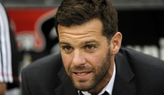 **FILE** D.C. United head coach Ben Olsen looks on from the bench before an MLS soccer game against the New England Revolution, Saturday, July 27, 2013, in Washington. (AP Photo/Nick Wass)