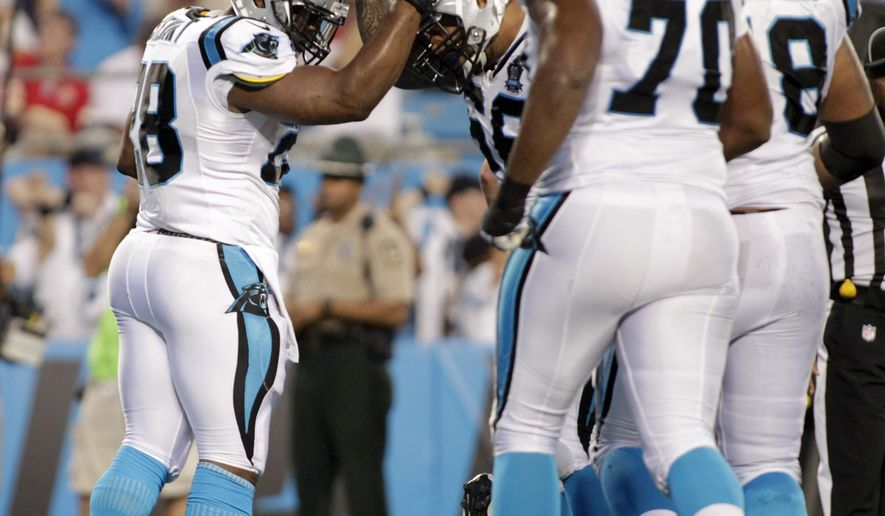 Carolina Panthers' Jonathan Stewart, left, is congratulated by teammates after his touchdown run against the Kansas City Chiefs during the first half of a preseason NFL football game in Charlotte, N.C., Sunday, Aug. 17, 2014. (AP Photo/Bob Leverone)