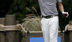Nick Watney reacts after hitting a tee shot on the second hole during the final round of the Wyndham Championship golf tournament in Greensboro, N.C., Sunday, Aug. 17, 2014. (AP Photo/Gerry Broome)
