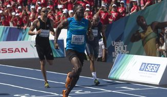 "Jamaican Olympic gold medallist Usain Bolt, front, wins the ""Mano a Mano"" men's 100m challenge in Rio de Janeiro, Brazil, Sunday, Aug. 17, 2014. (AP Photo/Silvia Izquierdo)"
