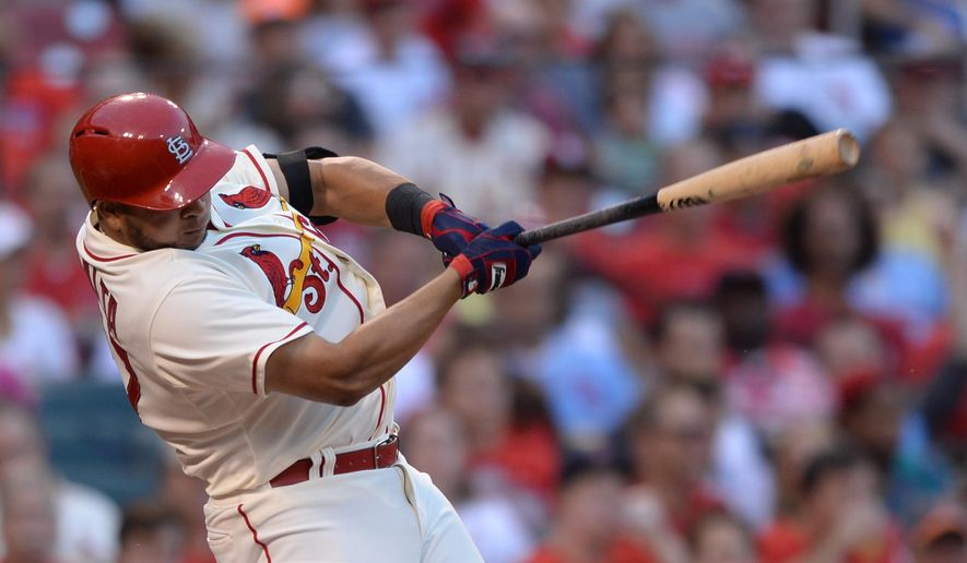 St. Louis Cardinals' Jhonny Peralta follows through on an RBI double against the San Diego Padres in the second inning in a baseball game, Saturday, Aug. 16, 2014, at Busch Stadium in St. Louis. (AP Photo/Bill Boyce)