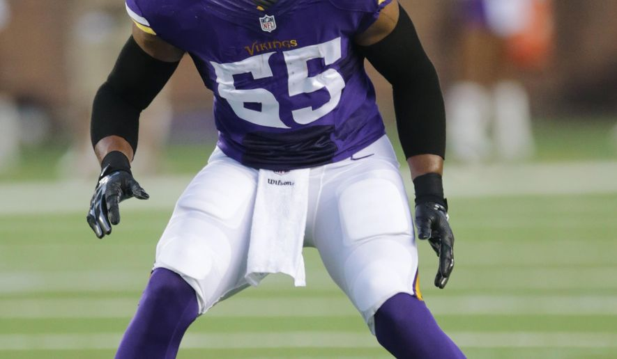 FILE - In this Aug. 16, 2014, file photo, Minnesota Vikings outside linebacker Anthony Barr gets set on the field during the first half of an NFL preseason football game against the Arizona Cardinals in Minneapolis. Barr has 1 1/2 sacks in his preseason action so far, and the Vikings have even experimented with him at defensive end. (AP Photo/Jim Mone, File)