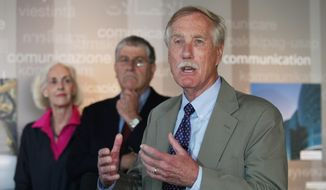 U.S .Sen. Angus King, right, speaks Monday, Aug. 18, 2014, in Portland, Maine during an event where he endorsed independent Eliot Cutler, center, for Maine governor. (AP Photo/Joel Page)
