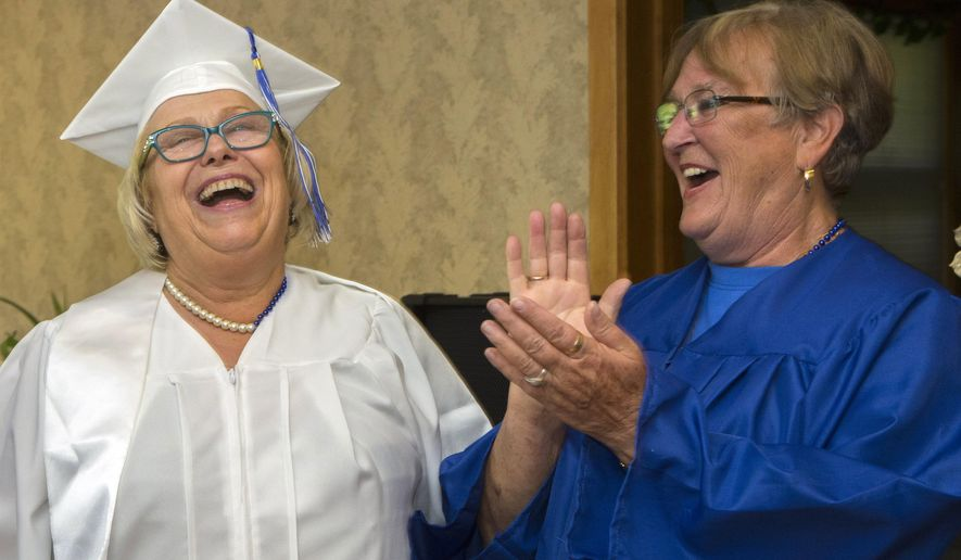 In an Aug. 16, 2014 photo, Sandra Kleven, left, laughs with friend and classmate Lynda Humphrey, who made it her mission to get Sandra a Bothell High diploma when Kleven recently returned to Bothell for her 51st class reunion. (AP Photo/The Seattle Times, Ellen M. Banner) OUTS: SEATTLE OUT, USA TODAY OUT, MAGAZINES OUT, TELEVISION OUT, SALES OUT. MANDATORY CREDIT TO:  ELLEN M. BANNER / THE SEATTLE TIMES.