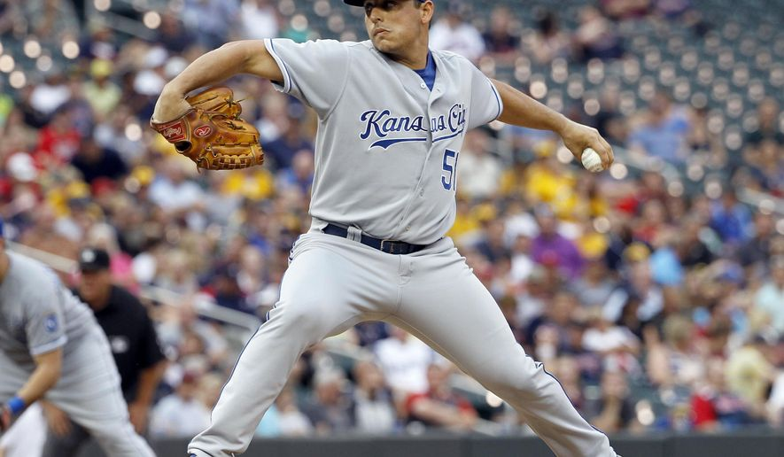 Kansas City Royals starting pitcher Jason Vargas delivers to the Minnesota Twins during the first inning of a baseball game in Minneapolis, Monday, Aug. 18, 2014. (AP Photo/Ann Heisenfelt)
