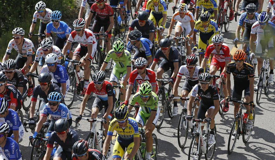 Riders climb a hill during the opening stage of the USA Pro Challenge bike race in Aspen, Colo. Monday Aug.18, 2014. The seven-stage race through the Colorado mountains finishes in Denver on Aug. 24. (AP Photo/Brennan Linsley)