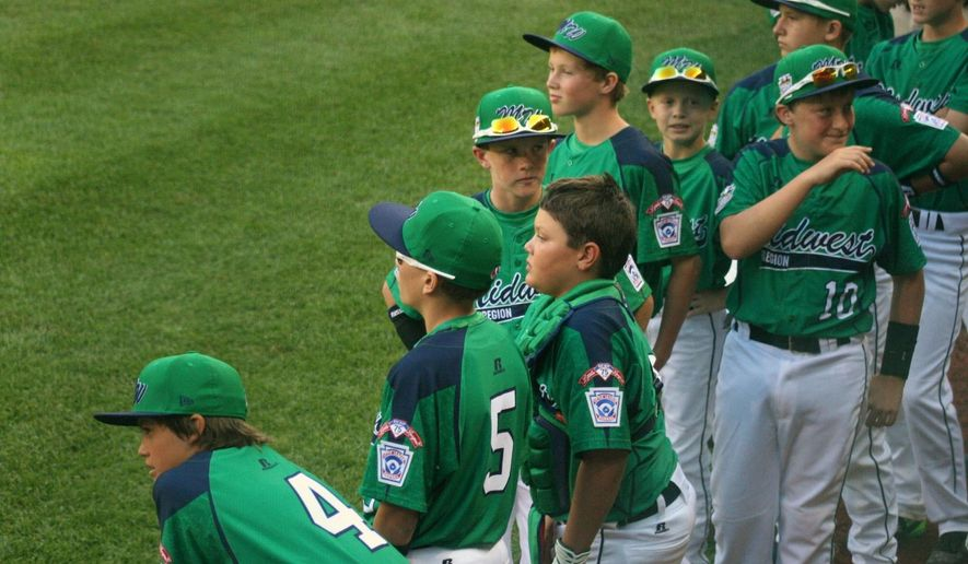 Rapid City, S.D, Canyon Lake Little League players line-up before their game Saturday, Aug. 15, 2014, at the Little League World Series in Williamsport, Pa. (AP Photo/Rapid City Journal, Richard Anderson ) TV OUT