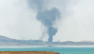Smoke rises from airstrikes targeting Islamic State militants in Mosul, Iraq. (Associated Press)