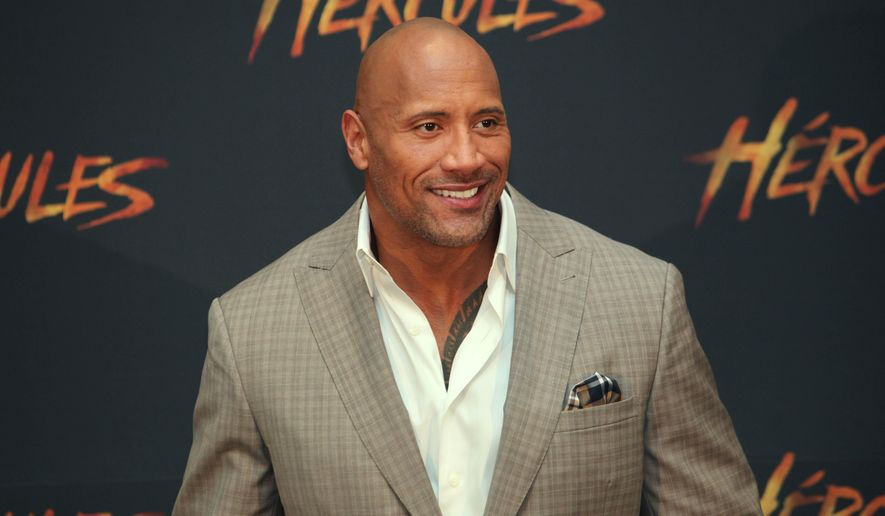 "U.S. actor Dwayne Johnson poses for photos as he arrives for an event to promote his film ""Hercules,"" in Mexico City, Monday, August 18, 2014. (AP Photo/Marco Ugarte)"