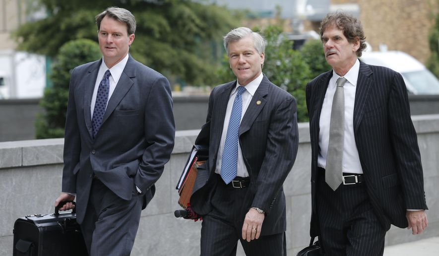 Former Virginia Gov. Bob McDonnell, center,   arrives at federal court with his attorneys, John Brownlee, left, and Henry Asbill, right, in Richmond, Va., Monday, Aug. 18, 2014. McDonnell presents his defense in his corruption trial today. (AP Photo/Steve Helber)