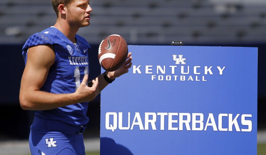 """FILE - In this Aug. 5, 2013, file photo, Kentucky NCAA college football quarterback Patrick Towles waits to be interviewed during media day at Commonwealth Stadium in Lexington, Ky. Kentucky coach Mark Stoops has announced that Towles will be the Wildcats' starting quarterback this season. Stoops tweeted out his decision before Monday's Aug. 18, 2014, practice, saying, """"this competition has brought out the best in our quarterbacks and I'm confident in Patrick moving our team forward.""""  (AP Photo/James Crisp, File)"""