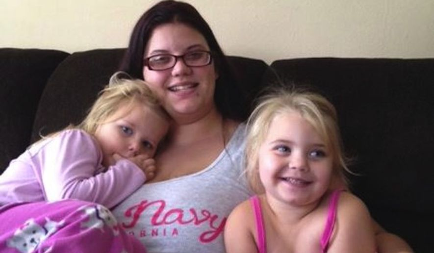 Danielle Wolf, 27, was grocery shopping with her two daughters when she was arrested for cursing in their presence. (WAGT 26)
