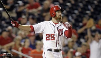Washington Nationals' Adam LaRoche follows through on a game-winning solo home run during the 11th inning of a baseball game against the Arizona Diamondbacks, Monday, Aug. 18, 2014, in Washington. The Nationals won 5-4 in 11 innings. (AP Photo/Luis M. Alvarez)
