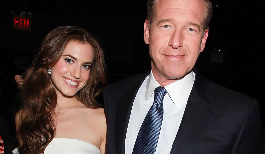 """FILE - This April 4, 2012 file photo shows Actress Allison Williams poses with her father, NBC News' Brian Williams, at the premiere of the HBO original series """"Girls,"""" in New York. Allison Williams  will star in the lead role of """"Peter Pan."""" NBC is airing a new version of the musical live on Dec. 4. (AP Photo/Starpix, Dave Allocca, FIle)"""