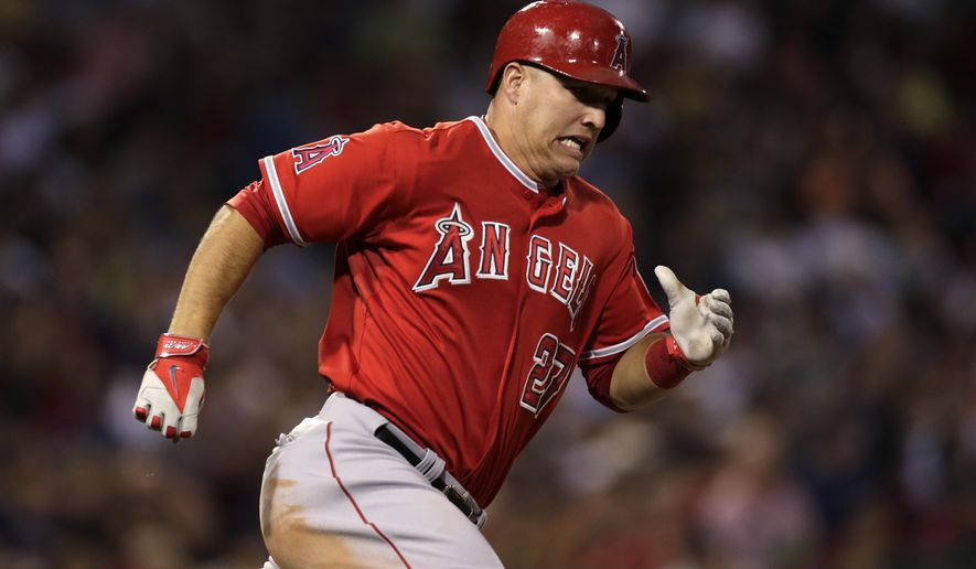Los Angeles Angels' Mike Trout dashes down the first base line on an RBI double during the third inning of a baseball game against the Boston Red Sox at Fenway Park in Boston, Monday, Aug. 18, 2014. (AP Photo/Charles Krupa)