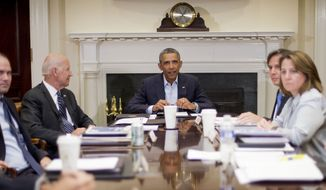 President Barack Obama and Vice President Joe Biden, left, meet with members of the National Security Council, Monday, Aug. 18, 2014, in the Roosevelt Room of the White House in Washington. Also at the meeting, from left are, Deputy National Security Adviser Ben Rhodes, Biden, Obama, Deputy National Security Adviser Tony Blinken, and Homeland Security Adviser Lisa Monaco. Obama took a break in the middle of his Martha's Vineyard vacation to return to Washington for meetings with advisers on the U.S. military campaign in Iraq and tensions between police and protesters in Ferguson, Missouri.  (AP Photo/Pablo Martinez Monsivais)