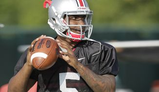 Ohio State quarterback Braxton Miller warms up during an NCAA college football practice on Saturday, Aug. 9, 2014, in Columbus, Ohio. (AP Photo/Jay LaPrete)