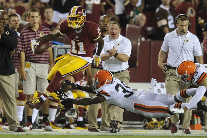Washington Redskins wide receiver DeSean Jackson (11) leaps for a first down in front of Cleveland Browns free safety Tashaun Gipson (39) and  cornerback Joe Haden (23)during first quarter action at FedEx Field, Aug. 18, 2014. (Preston Keres/Special for The Washington Times)