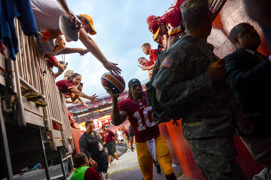 Washington Redskins quarterback Robert Griffin III (10) heads to the locker room before the Washington Redskins play the Cleveland Browns in NFL preseason football at FedExField, Landover, Md., Monday, August 18, 2014. (Andrew Harnik/The Washington Times)