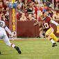 Washington Redskins quarterback Robert Griffin III (10) scrambles for a gain in the first quarter as the Washington Redskins play the Cleveland Browns in NFL preseason football at FedExField, Landover, Md., Monday, August 18, 2014. (Andrew Harnik/The Washington Times)