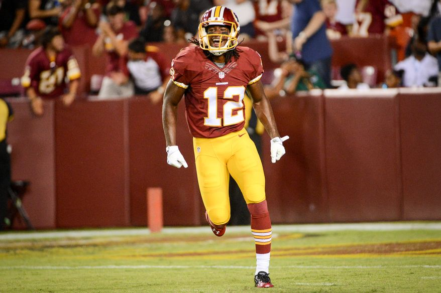 Washington Redskins wide receiver Andre Roberts (12) celebrates after a 49 yard catch to end the first quarter as the Washington Redskins play the Cleveland Browns in NFL preseason football at FedExField, Landover, Md., Monday, August 18, 2014. (Andrew Harnik/The Washington Times)