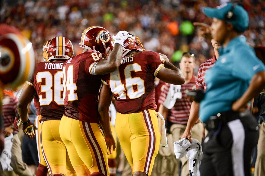 Washington Redskins tight end Niles Paul (84) congratulates Washington Redskins running back Alfred Morris (46) after scoring a touchdown, which was later overturned after a review, in the second quarter as the Washington Redskins play the Cleveland Browns in NFL preseason football at FedExField, Landover, Md., Monday, August 18, 2014. (Andrew Harnik/The Washington Times)