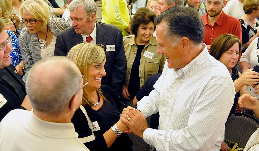 Former Massachusetts Gov. Mitt Romney shakes hands with supporter Mary Jo Pitzer at Tamarack during the Working for Jobs Rally in Beckley, W.Va., Tuesday, Aug. 19, 2014. (AP Photo/Chris Tilley)