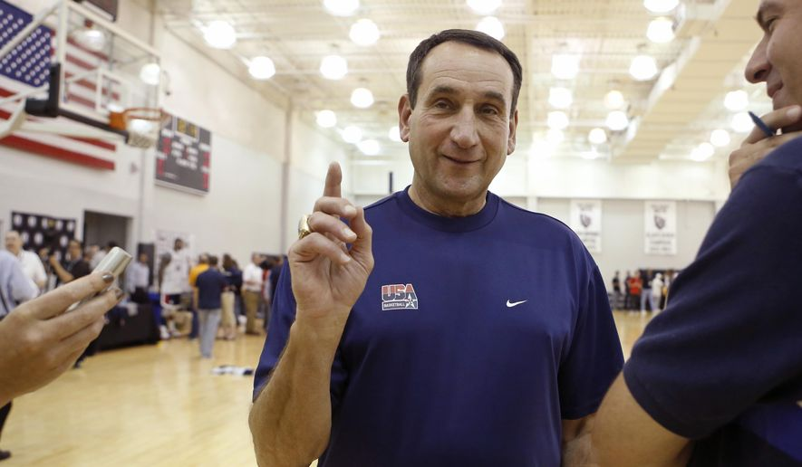 USA Basketball head coach Mike Krzyzewski of Duke University answers reporters questions following a team practice at the Brooklyn Nets training facility in East Rutherford, N.J., Tuesday, Aug. 19, 2014.  (AP Photo/Kathy Willens)