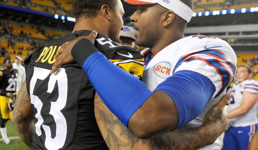 Pittsburgh Steelers center Maurkice Pouncey (53) greets Buffalo Bills quarterback EJ Manuel (3) after an NFL football preseason game on Saturday, Aug. 16, 2014, in Pittsburgh. The Steelers won 19-16. (AP Photo/Vincent Pugliese)