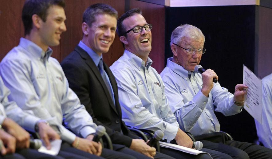Joe Gibbs, right, speaks as drivers Daniel Suarez, left, Carl Edwards, second from left, and J.D. Gibbs, second from right, laugh during a news conference at Joe Gibbs Racing's headquarters in Huntersville, N.C., Tuesday, Aug. 19, 2014. Joe Gibbs Racing has hired Carl Edwards to drive a new fourth Sprint Cup car in 2015 and Daniel Suarez will drive in the Nationwide series. (AP Photo/Chuck Burton)