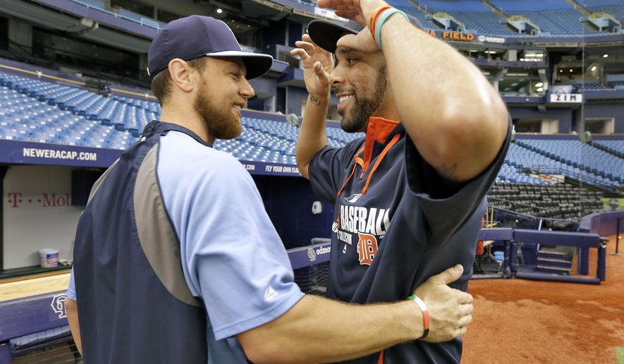 Detroit Tigers pitcher David Price, right, greets former teammate, Tampa Bay Rays' Ben Zobrist, before a baseball game Tuesday, Aug. 19, 2014, in St. Petersburg, Fla. Price was traded from the Rays to the Tigers on July 31. (AP Photo/Chris O'Meara)