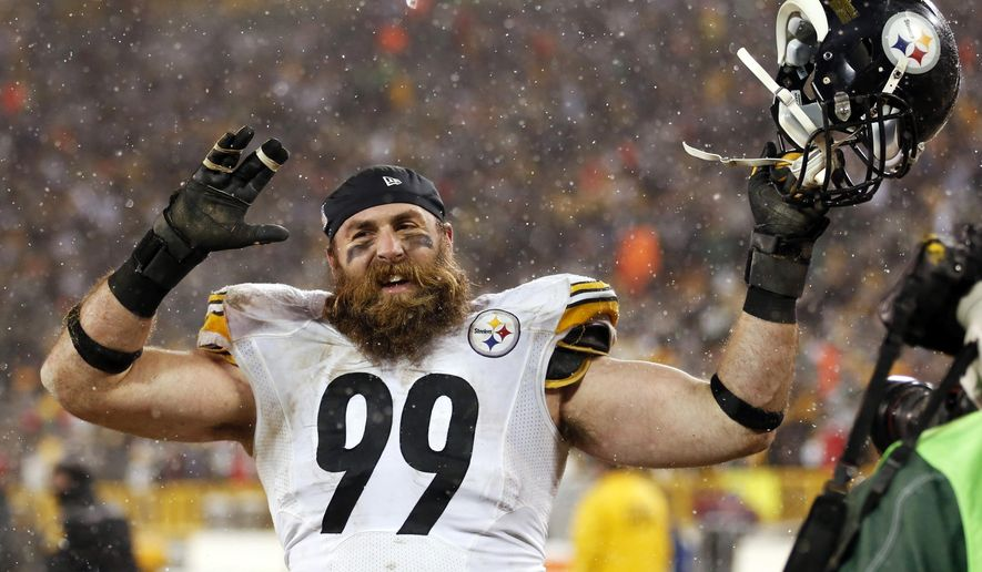 FILE - In this Dec. 22, 2013, file photo, Pittsburgh Steelers' Brett Keisel celebrates after an NFL football game against the Green Bay Packers in Green Bay, Wis. The Steelers are planning to re-sign defensive end Keisel to bolster a reconfigured line that has struggled to produce much of anything in the first two weeks of the preseason. (AP Photo/Jeffrey Phelps, File)