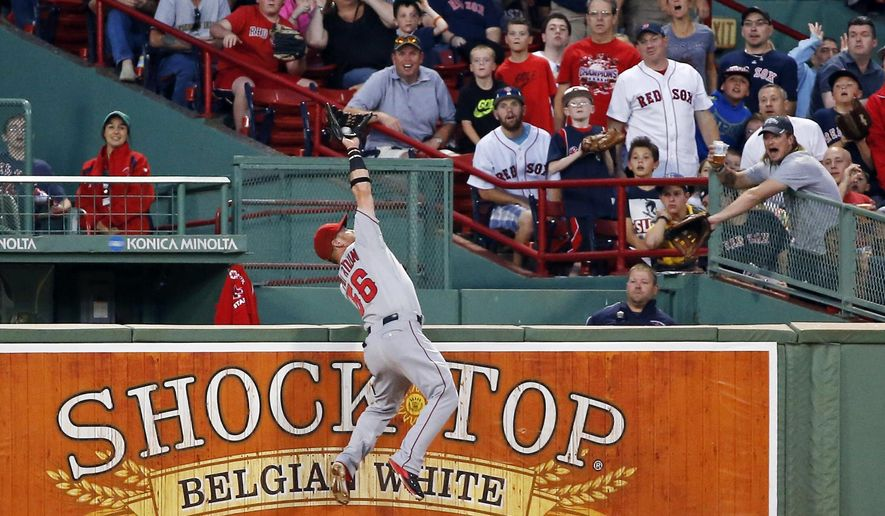 Los Angeles Angels right fielder Kole Calhoun makes a leaping catch of a deep fly ball by Boston Red Sox's Brock Holt in the second inning of a baseball game at Fenway Park in Boston, Tuesday, Aug. 19, 2014. (AP Photo/Elise Amendola)
