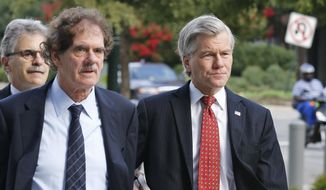Former Virginia Gov. Bob McDonnell, right, arrives at federal court with his attorney Henry Asbill in Richmond, Va., Tuesday, Aug. 19, 2014. McDonnell is presenting the second day of his defense on corruption charges. (AP Photo/Steve Helber)