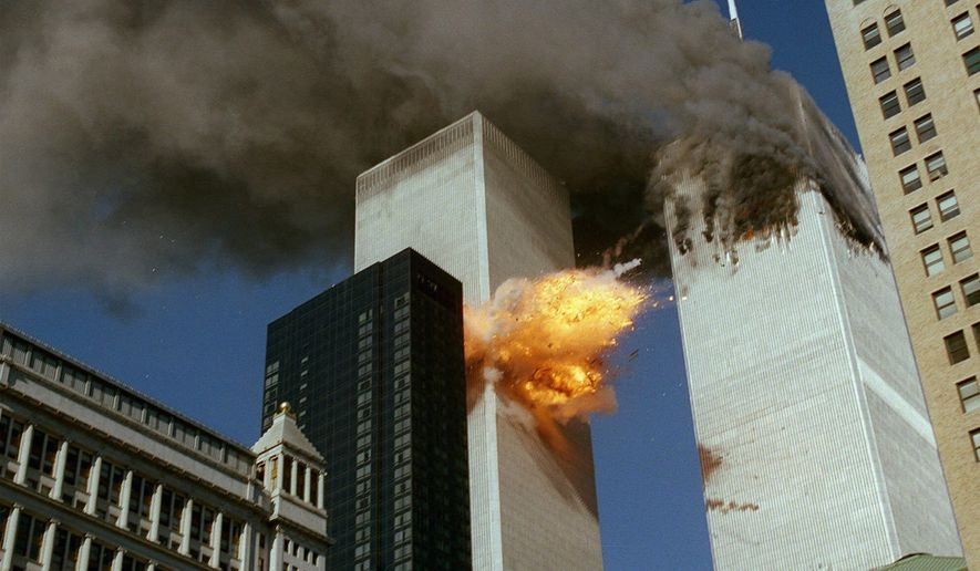 In this Sept. 11, 2001 file photo, United Airlines Flight 175 collides into the south tower of the World Trade Center in New York as smoke billows from the north tower. (AP Photo/Chao Soi Cheong)