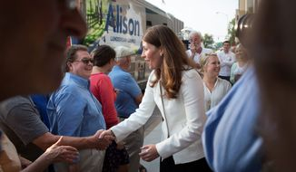 Senate Minority Leader Mitch McConnell's campaign is hitting Democrat Alison Lundergan Grimes for renting a bus acquired by her father's company for less than what other similar services would charge. (Associated Press)