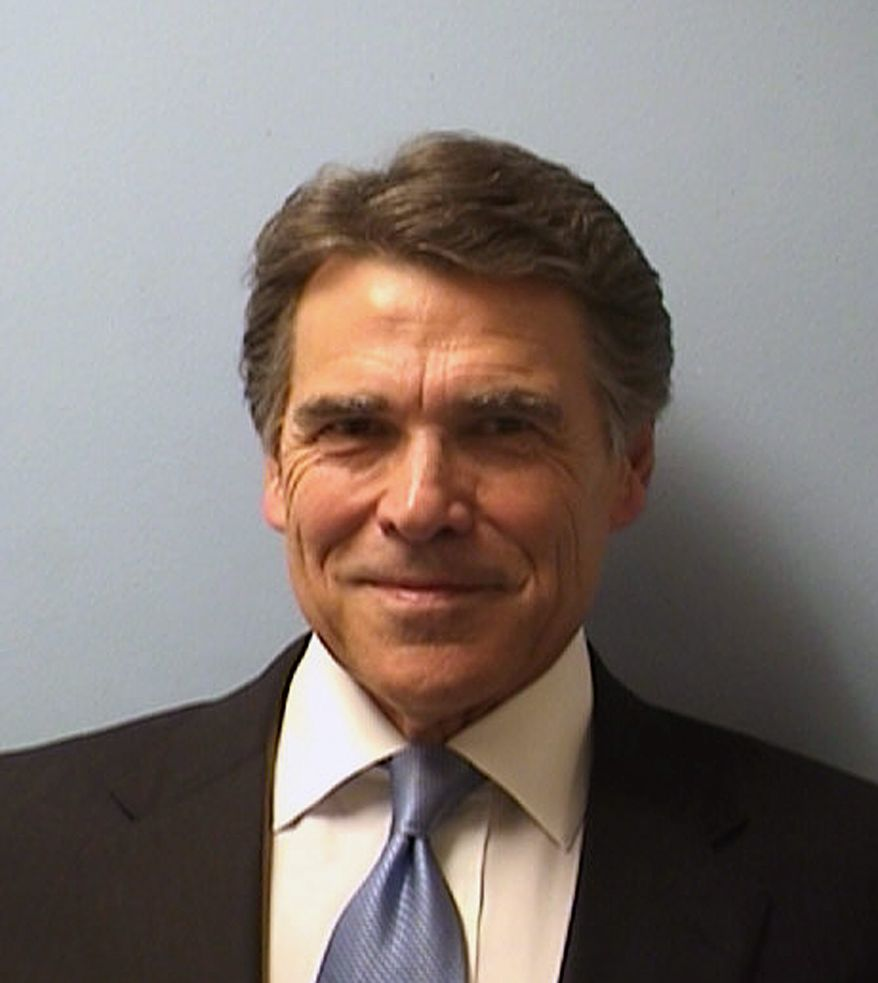 Texas Gov. Rick Perry being booked at the Blackwell-Thurman Criminal Justice Center in Austin, Texas, for two felony indictments of abuse of power on Tuesday. (AP Photo/Austin Police Department)
