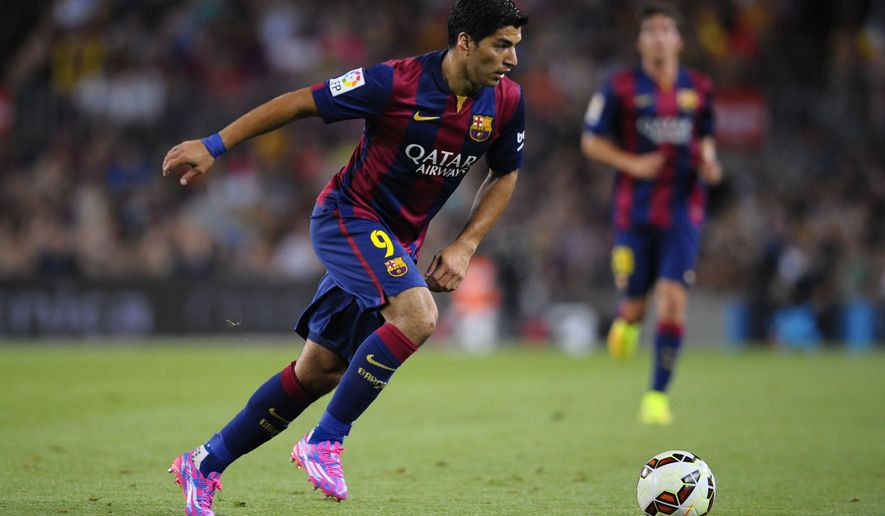 Barcelona's Luis Suarez, from Uruguay, controls the ball during the Joan Gamper trophy friendly soccer match against Leon at the Camp Nou in Barcelona, Spain, Monday, Aug. 18, 2014. (AP Photo/Manu Fernandez)