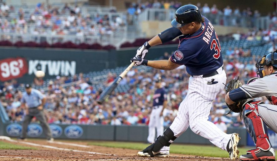 Minnesota Twins' Oswaldo Arcia hits a three-run home run off Cleveland Indians starting pitcher Trevor Bauer in the first inning of a baseball game,Tuesday, Aug. 19, 2014, in Minneapolis. (AP Photo/Jim Mone)